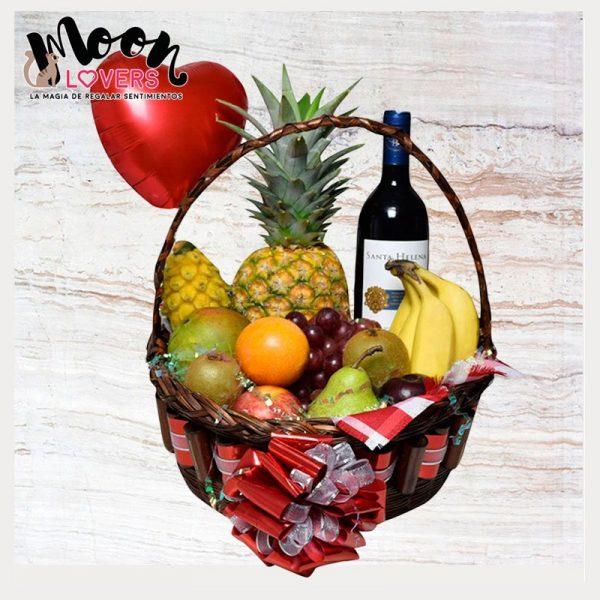 canasta de frutas con vino